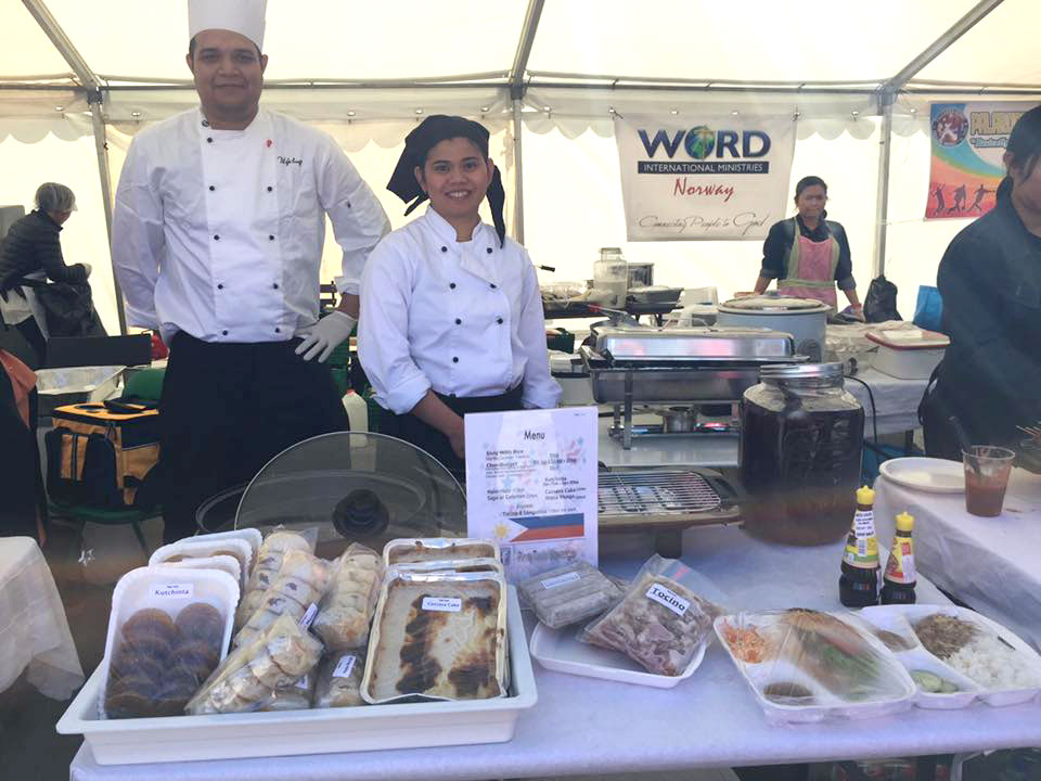 Raquel Landayan (right) and her husband Arie Bob Riesenbeck present some of their Filipino specialties at an event in Norway.