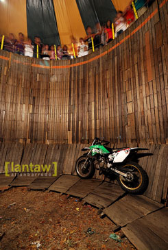 The more primitive version wherein the motorcycle spun horizontally on the vertical walls!