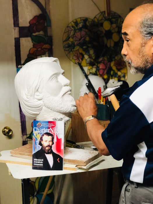 Mogi chisels bust of Blessed Frederic Ozanam, founder of Society of St. Vincent de Paul. (Photo by Marisa S. Roque)