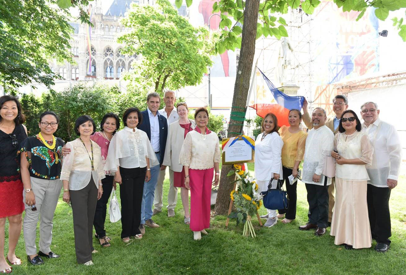 Members of the Filipino community in Vienna with the centennial tree in Vienna's city hall during the 121st anniversary of Philippine Independence. Malou is at the center.