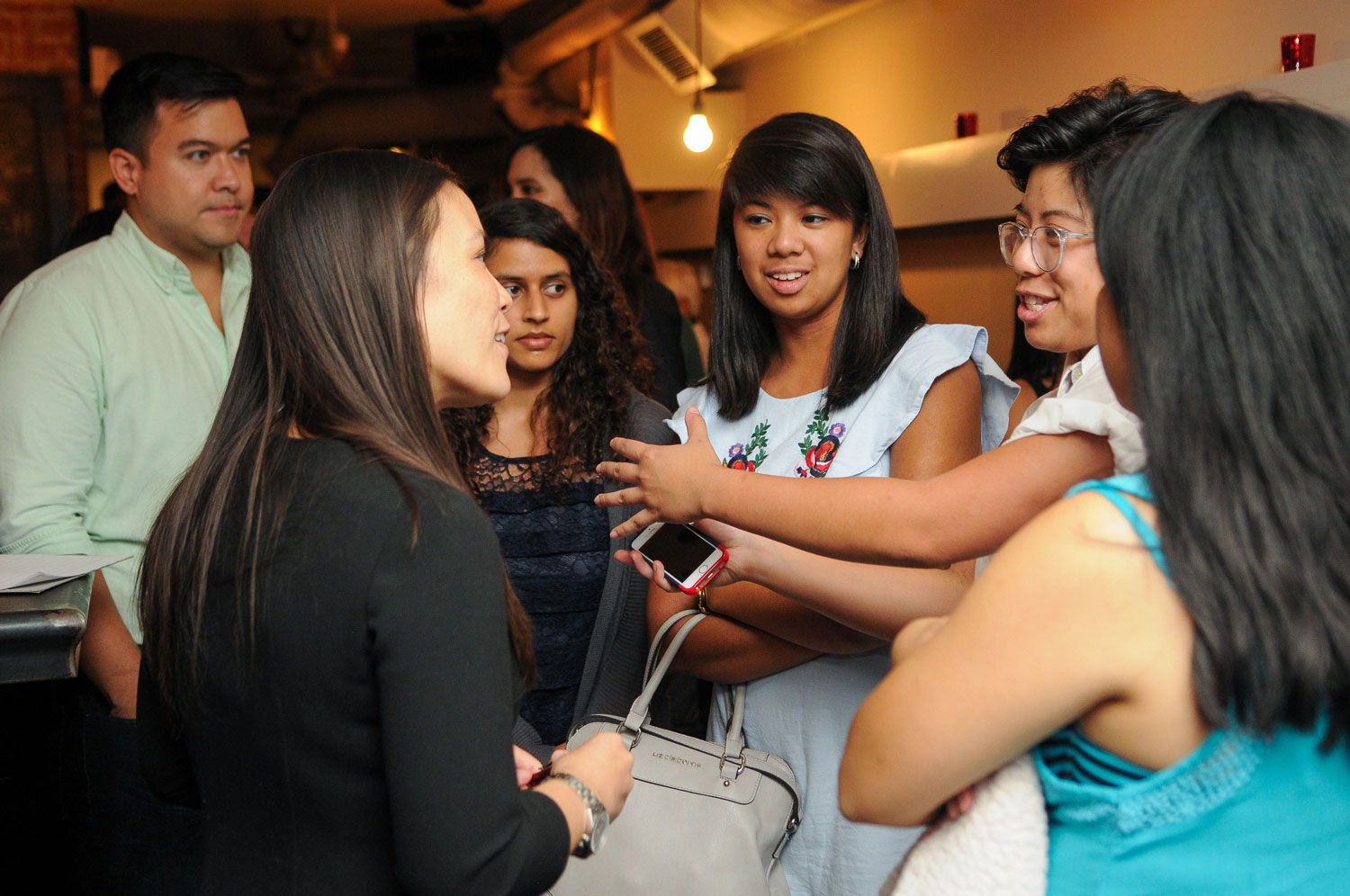Jones bonds with fellow millennials of KAYA: Filipino Americans for Progress, a 10-year-old grassroots organization engaged in political advancement of Filipino Americans. (Ana Isabel Photography)