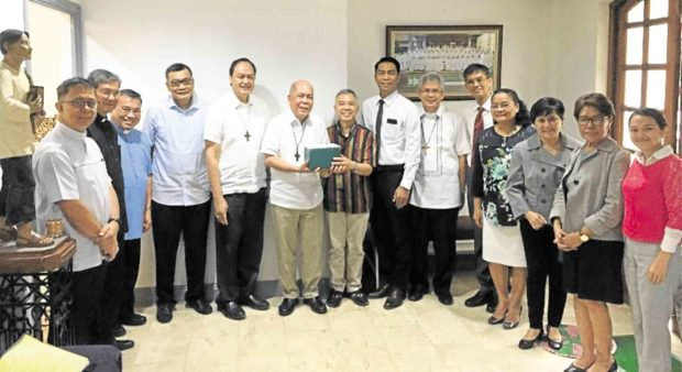 Bishop David, Archbishop Valles, Jose, Ordinario (center) and other CBCP and Mormon officials (Source: inquirer.net)