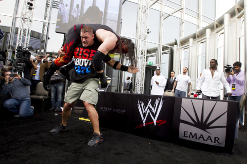 DUBAI, UAE. Feb 9th, 2012 –  WWE wrestler John Cena prepares to bodyslam Kane at a press conference atop the Burj Khalifa.