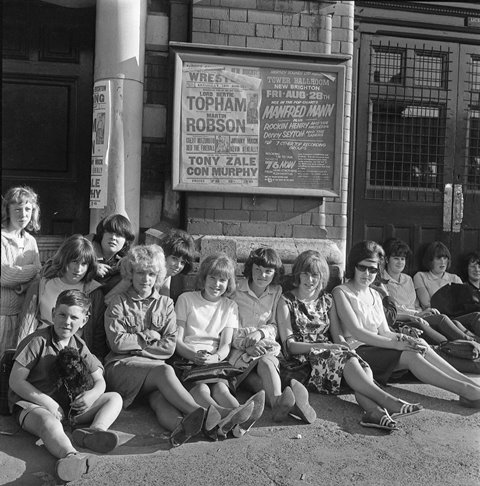 """Teenagers outside the Tower Ballroom  """"We'd get the ferry over and then the last boat home, then you'd have to bomb it for the last boat home – half eleven. Then you had to walk home from the Pier Head because there would be no buses or nothing."""" Molly Edmonds, Kensington Fields Community Association"""