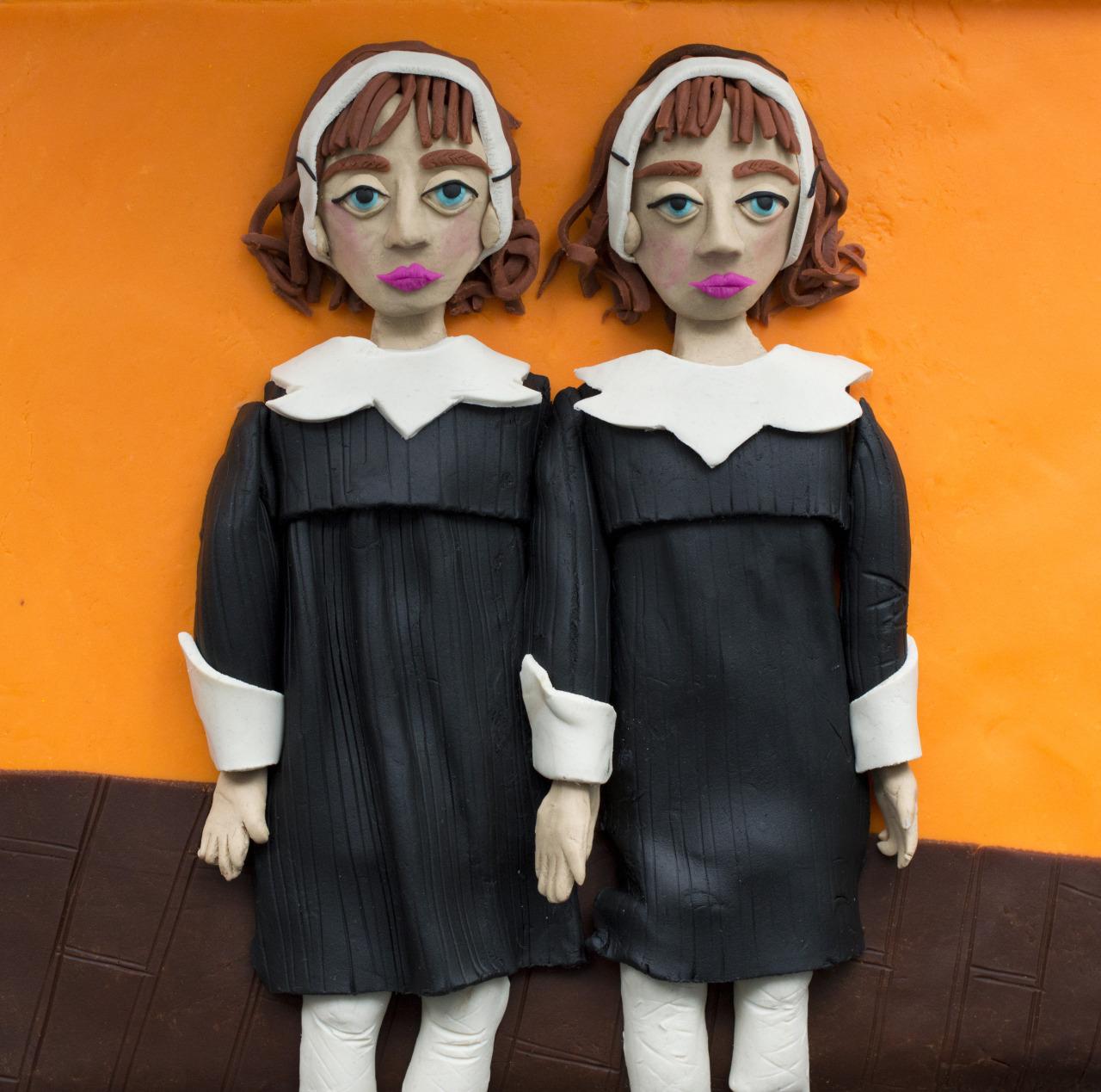 Eleanor Macnair. Original photograph:  Identical Twins, Roselle, N.J.,  1967 by Diane Arbus