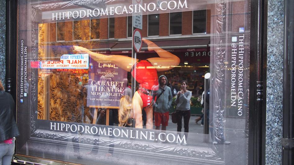 Performing handbalancing in the window display of the Hippodrome Casino.