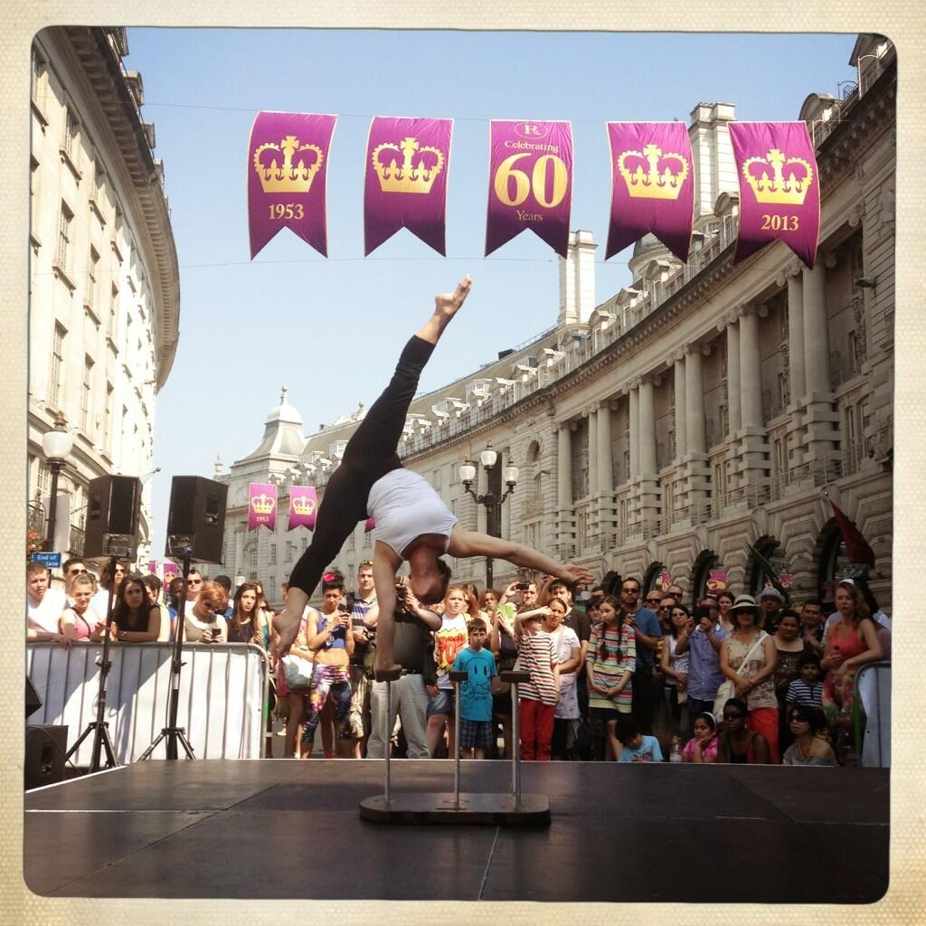 Performing my handbalancing act on the stage on Regents Street.