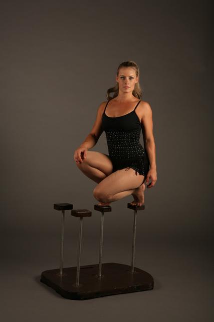 Zoe_Jones_sitting_on_handstand_canes_web.jpg