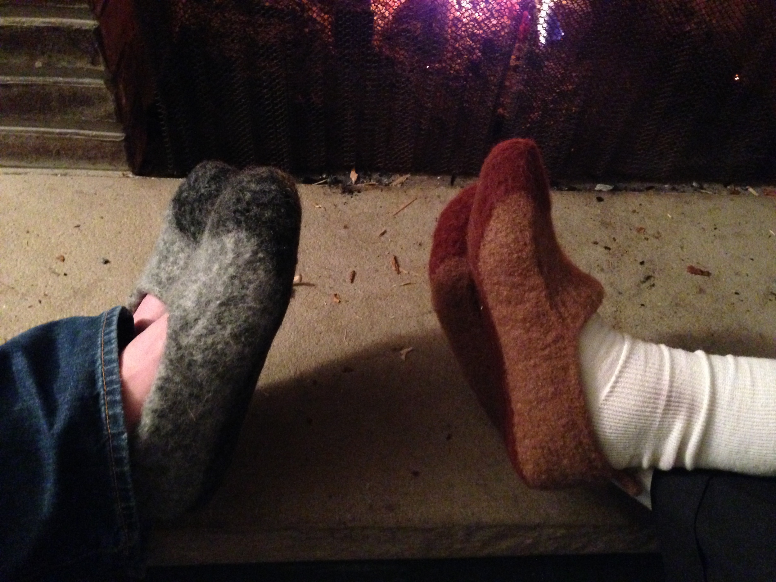 Finally, two pairs of slippers on their first fireside relaxation run.  These are  Duffers Revisited by Mindie Tallack , the original pattern in grey for (another) brother-in-law and with a bit of a tongue added (with inspiration from some other Ravelers' projects) in the browns for my father-in-law.