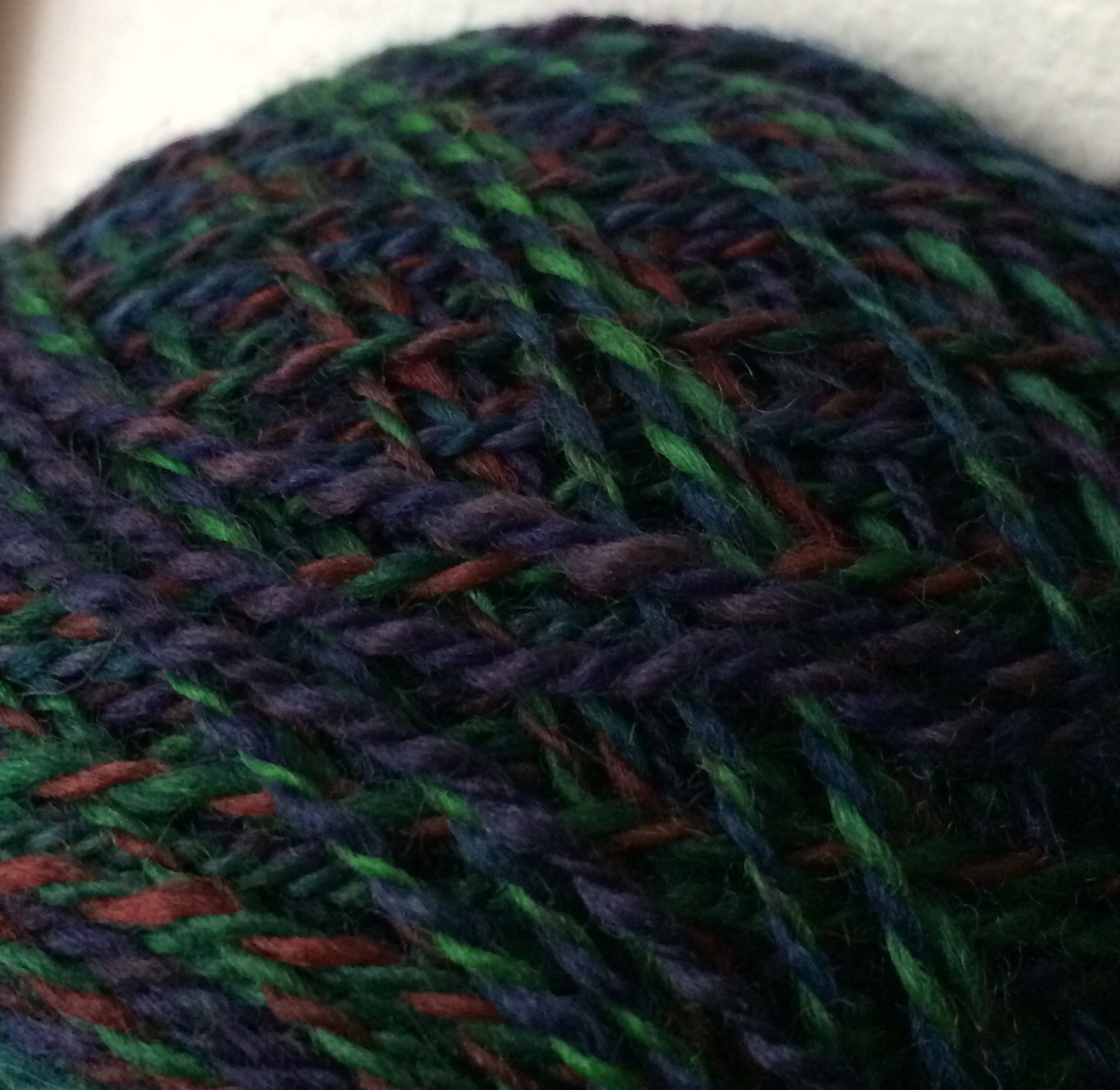 It's a BFL 2-ply by Sandi Spins. I don't think she has a website, so if you'd like contact info, email me!