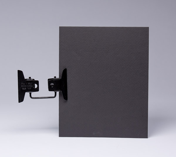 The Multi-Clip and black cardboard