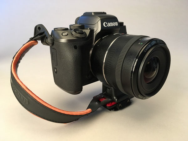 Canon EF to EOS M lens adapter has a tripod mount where I attach my tripod plate and my ever-present hand strap.