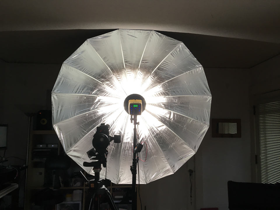 Flash head mounted as far out on the umbrella shaft as possible