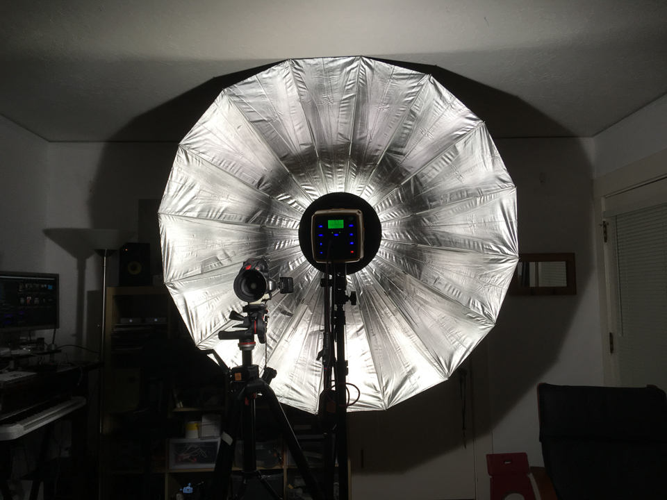 Flash head mounted on a separate stand 5-feet out from the umbrella
