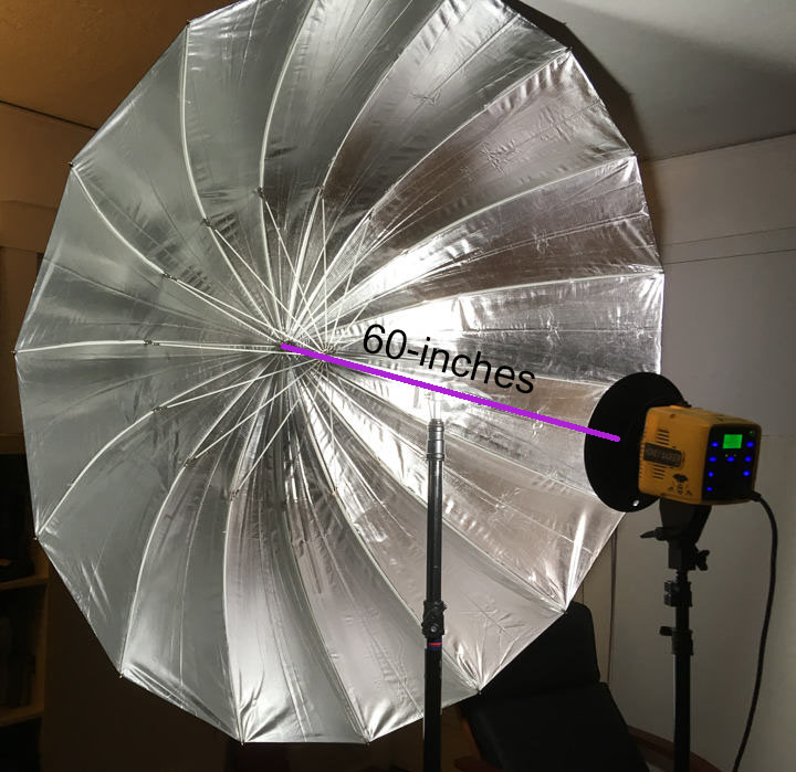 Strobe head mounted on a separate stand 5 feet in front of the Interfit 65-inch Silver Parabolic Umbrella
