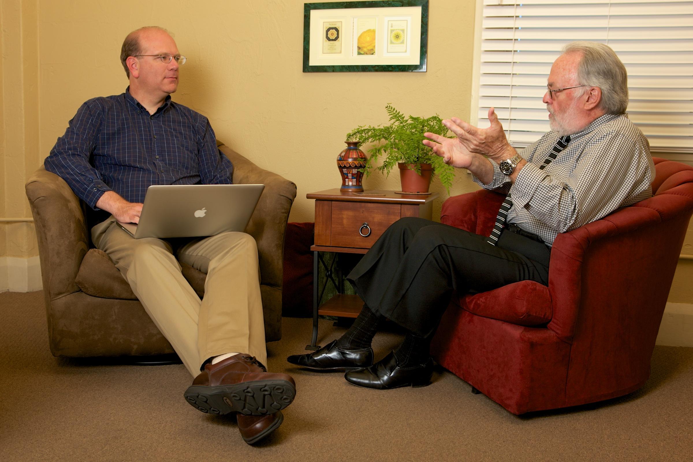 John interviewing an older adult male.
