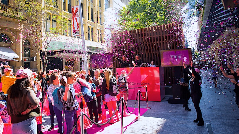 DJ, music, freebies, entertainment, giveaways, fun and excitement captured by Brisbane top Event Photographer at the Mecca grand opening event.