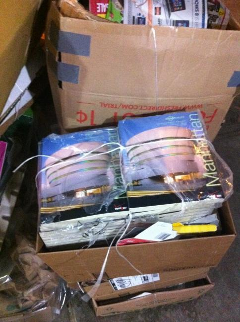 Stack of phone directories sitting in a pile of trash on my street
