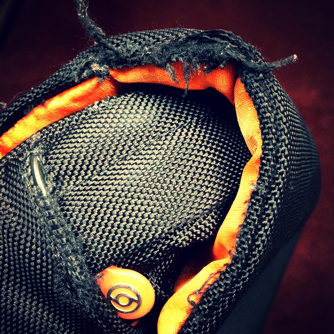 The photo I sent to Booq showing my first Booq bag with the unraveling of the lining.