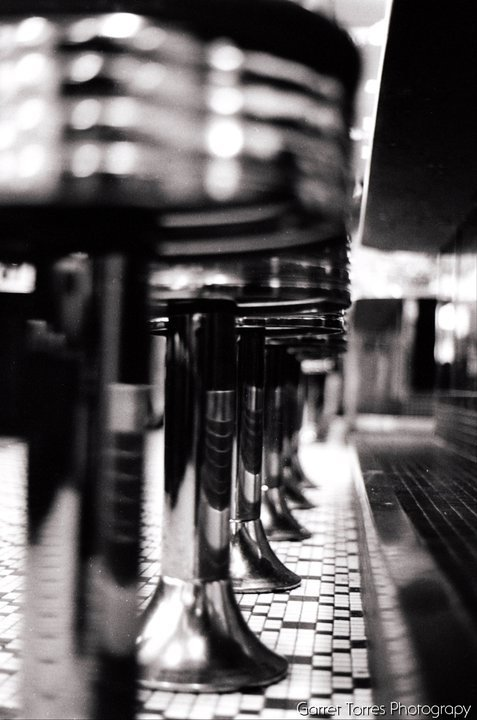 One of the first photos I can remember being happy about. I took this one in my college's on-campus diner in 2010. Minolta XG-1 on Ilford 400 HP5 Plus film.