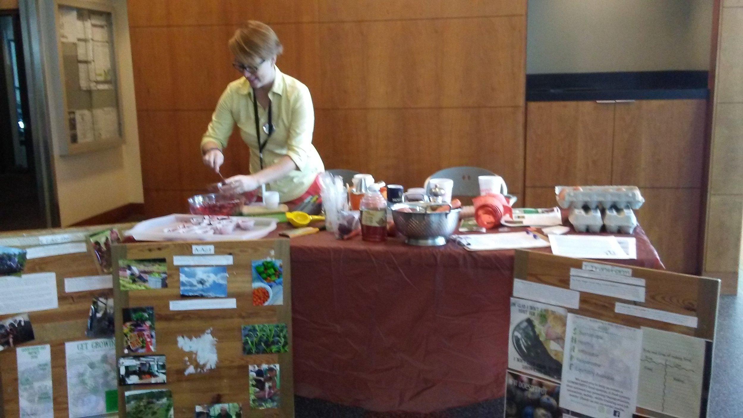 E.A.T. South Executive Director Beth Anne Dunagan serves up Rainbow Crunch Salad at a recent Wellness Fair.