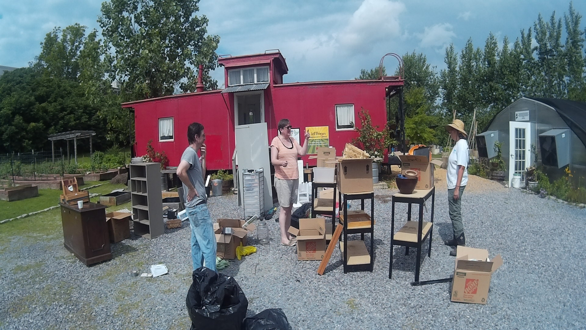 One pile for storage, one pile for the shipping container, one for garbage, and one for recycling