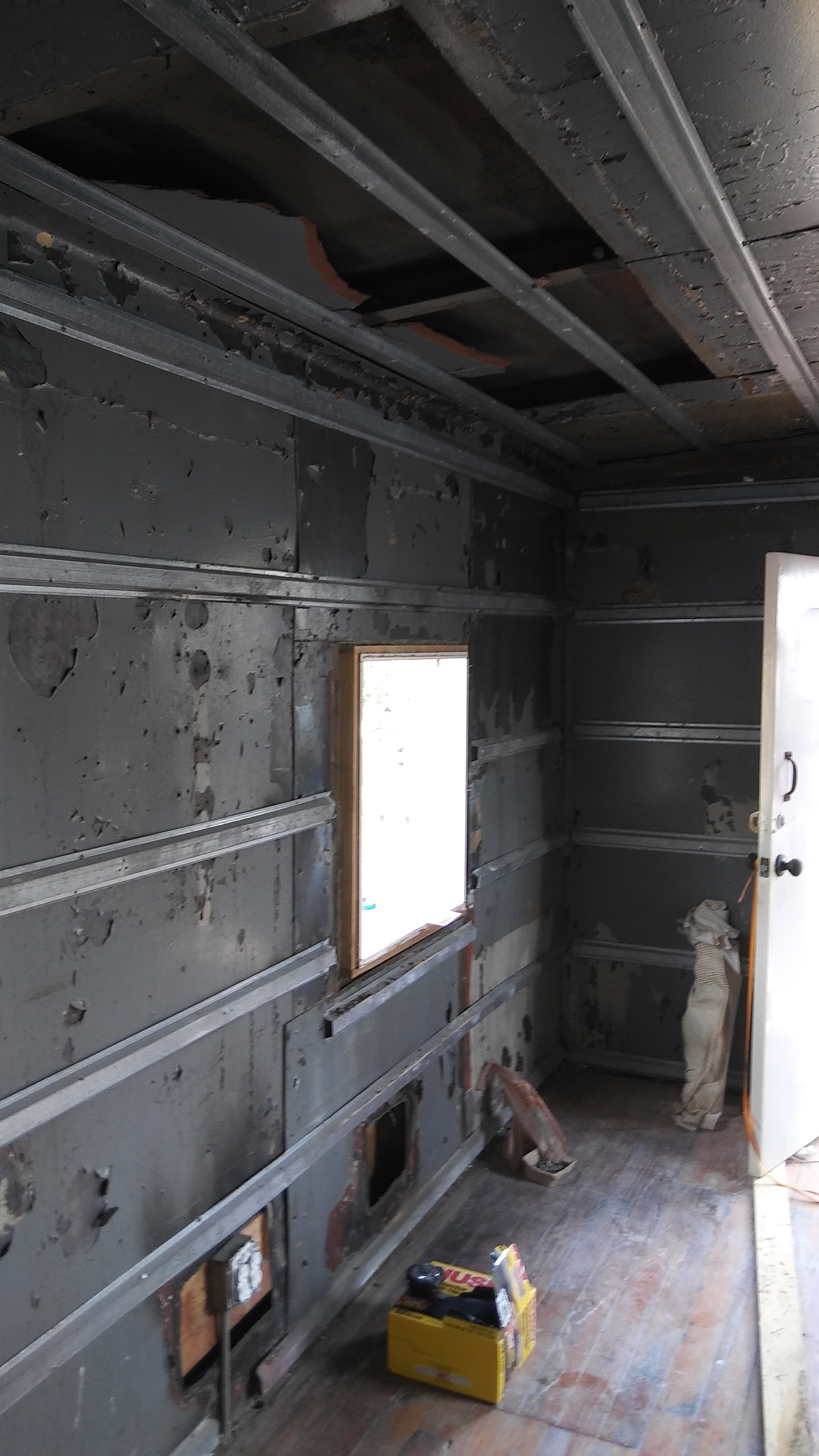 Ceiling and wall detail on the south side of the caboose. The metal studs were added to hang the sheet rock. There is space for blow-in insulation in between the ceiling, wall and external wall/roof. There was also a lot of evidence of rodent life.