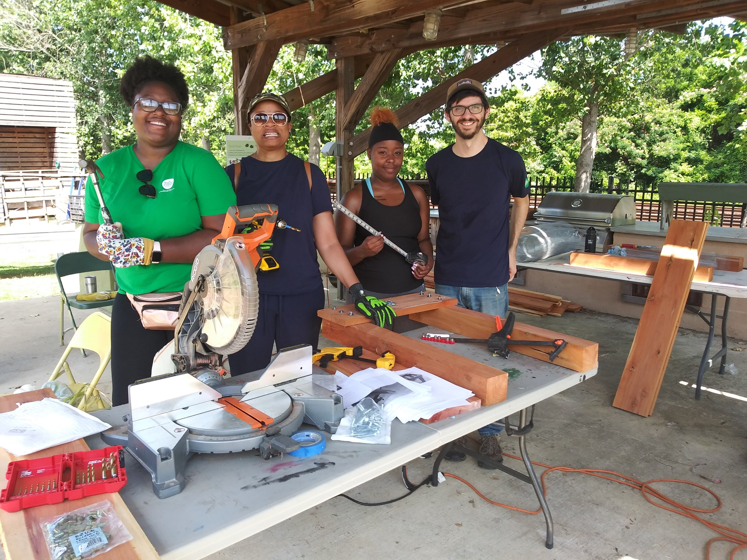 First Saturday volunteers from Whole Foods help build garden beds.