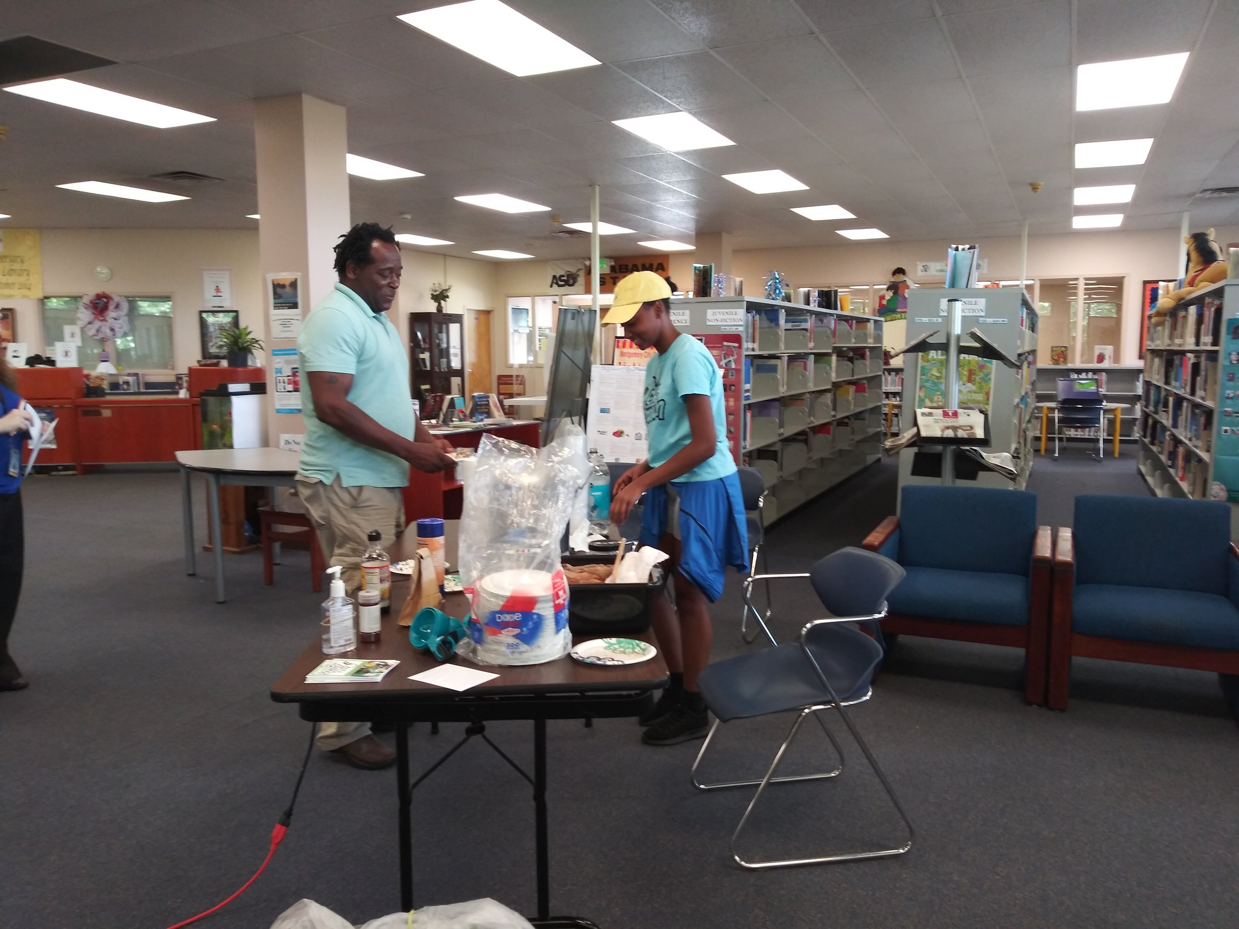 Summer intern Dalayli Franklin serving up healthy snacks at the library.