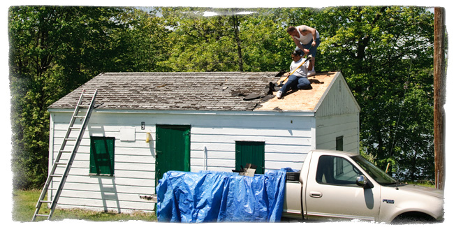 Volunteers replace the roof on Cabin 9.