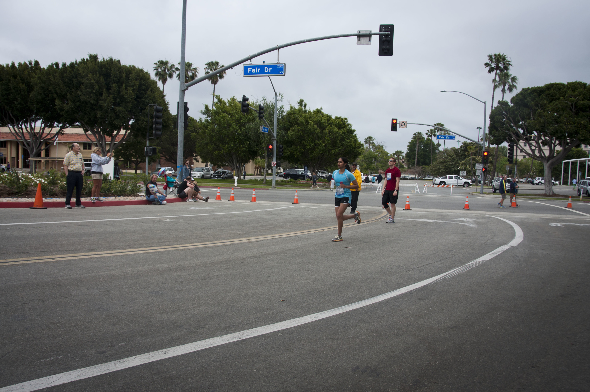 meghana running to the finish line looking graceful as ever! 26 miles in 4 HOURS AND 20 MINUTES!