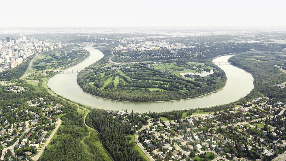 North Saskatchewan River Valley as seen from the air. With over 20 major parks and attractions, 7,400 hectares of land and a river valley that's 22 times the size of New York City's Central Park, there's tons to explore.