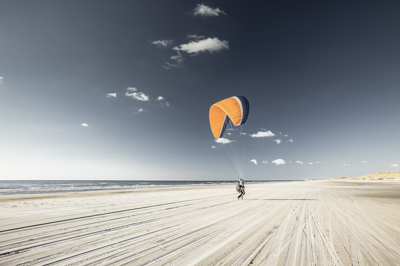 A parasailer on the beach. Such a great sight in the low sun.