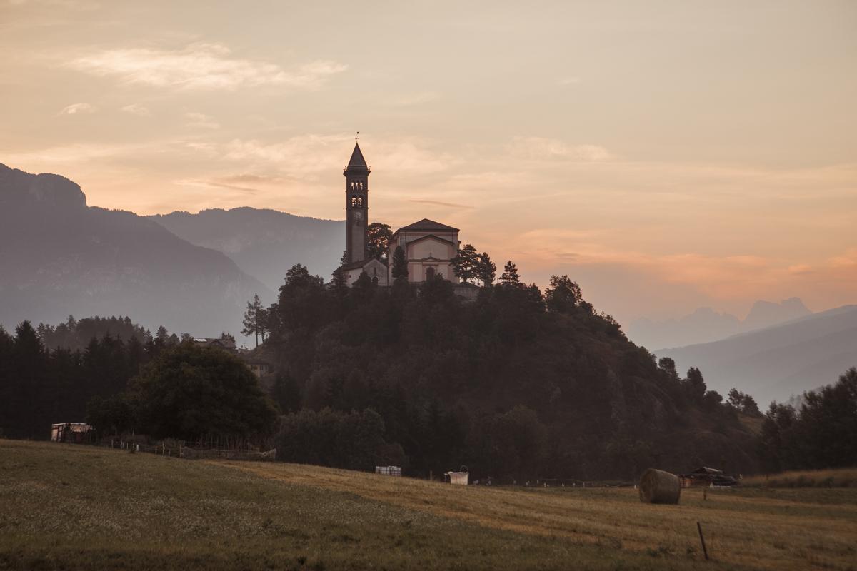 The Church of San Giorgio, located on a hill that dominates the town of Castello-Molina di Fiemme.