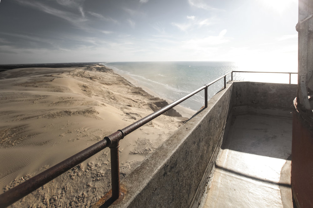 View from the lighthouse, where the sand from the dunes is being blown in the air
