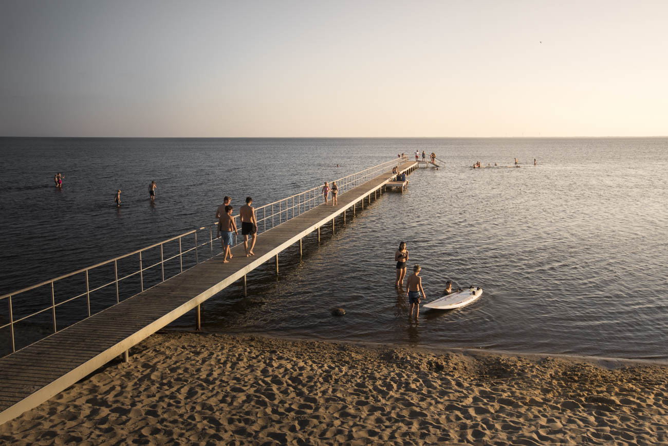 People enjoying a summer evening at a jetty at Ringkøbing