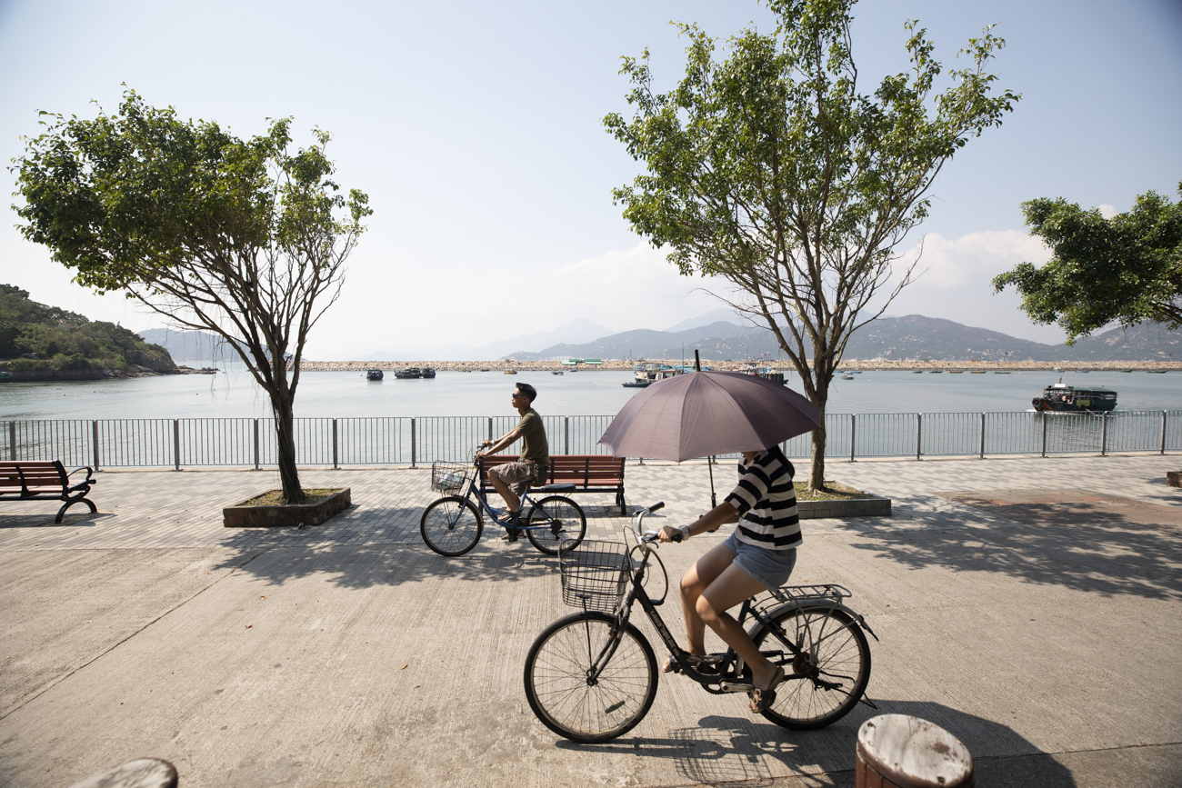 Simply rent a bike and to enjoy the views on the Sai Tai Road