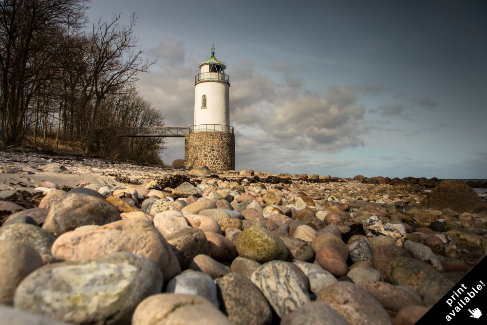 The idyllic lighthouse of  Taksensand  at the edge of the forest.