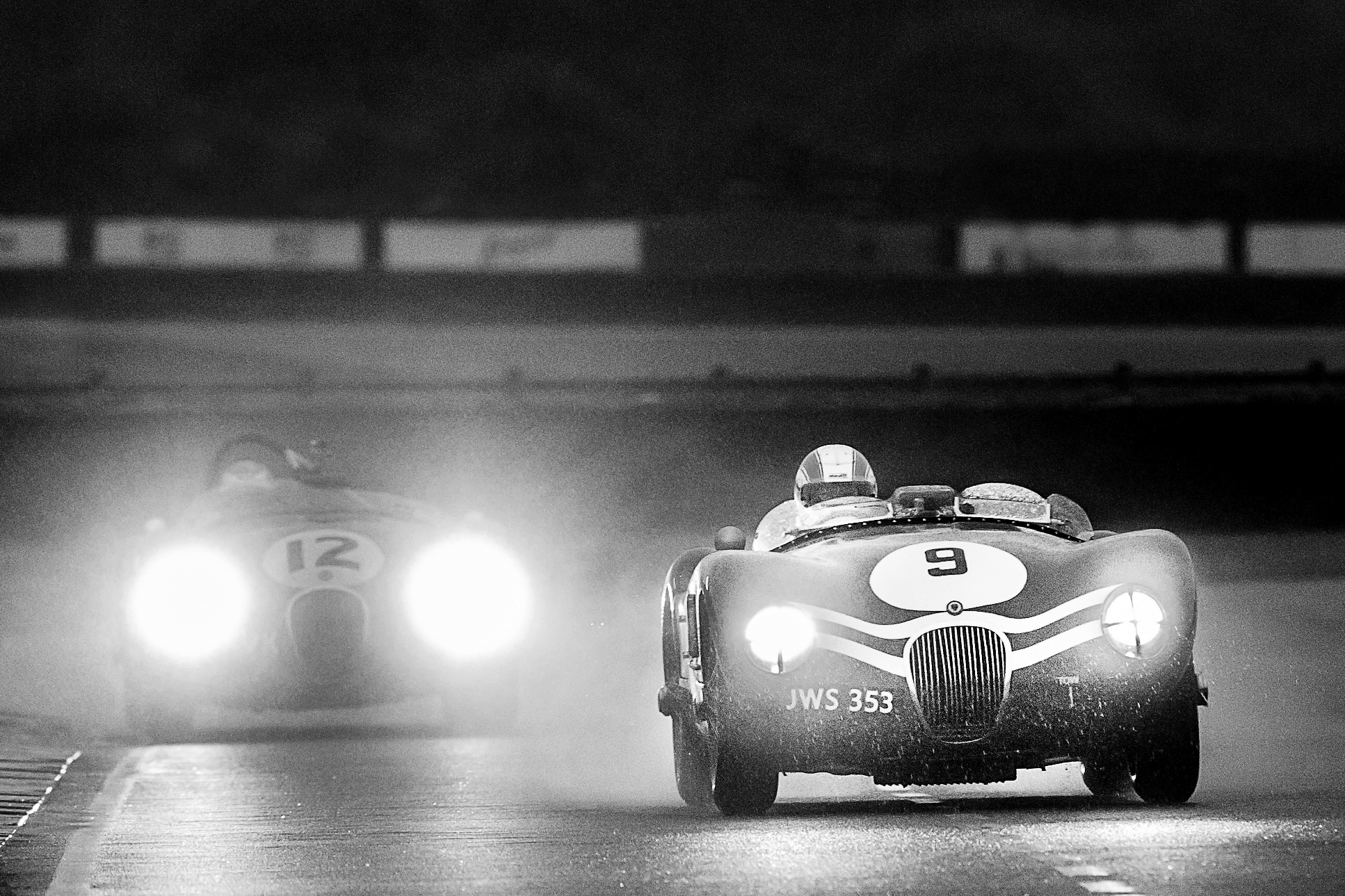 Sam Hancock in the ex-Ecurie Ecosse Jaguar C-Type leads Alex Buncombe in the Freddie March Memorial Trophy.  Image: Fluid Images