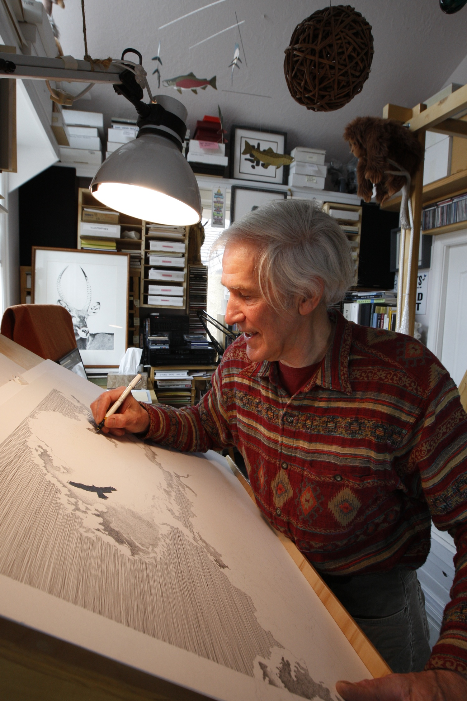 "Fred Montague stipples cloud details on ""Feathers that Touch the Clouds"". Photo by Tom Smart."