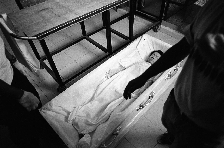 Copy of death dead deceased philippines manila woman female casket