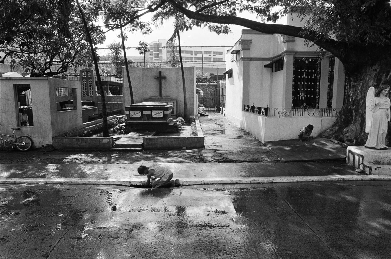 rain water wet north cemetery philippines manila