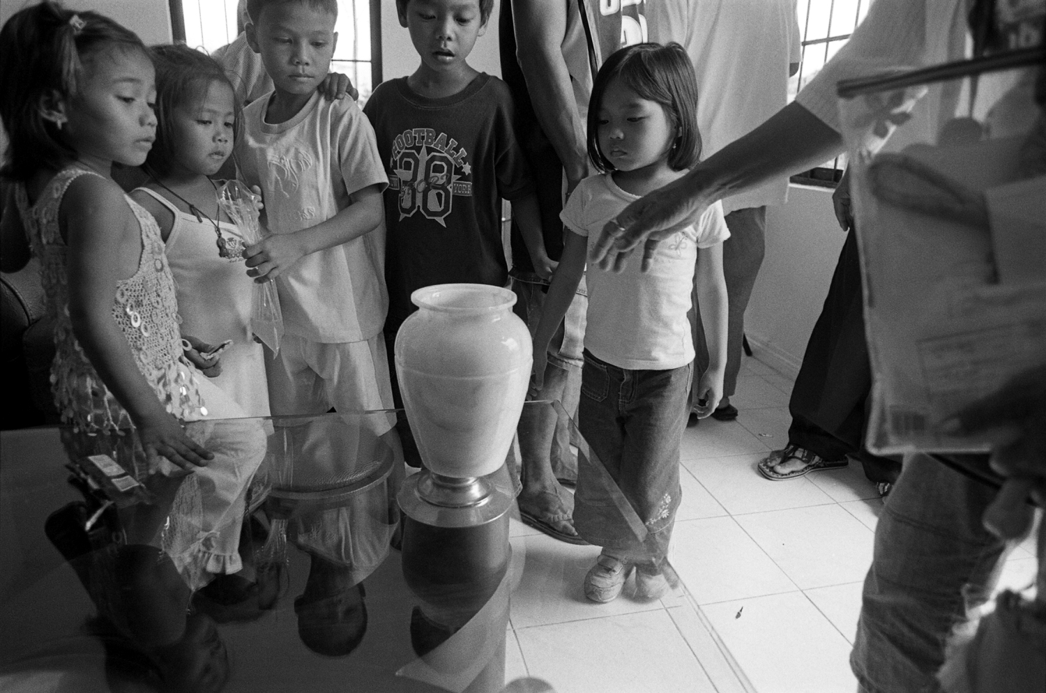 children urn death dying 35mm black and white philippines manila
