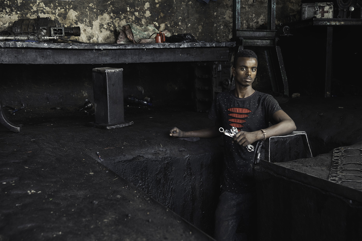 Mechanic in oil pit in Ethiopia