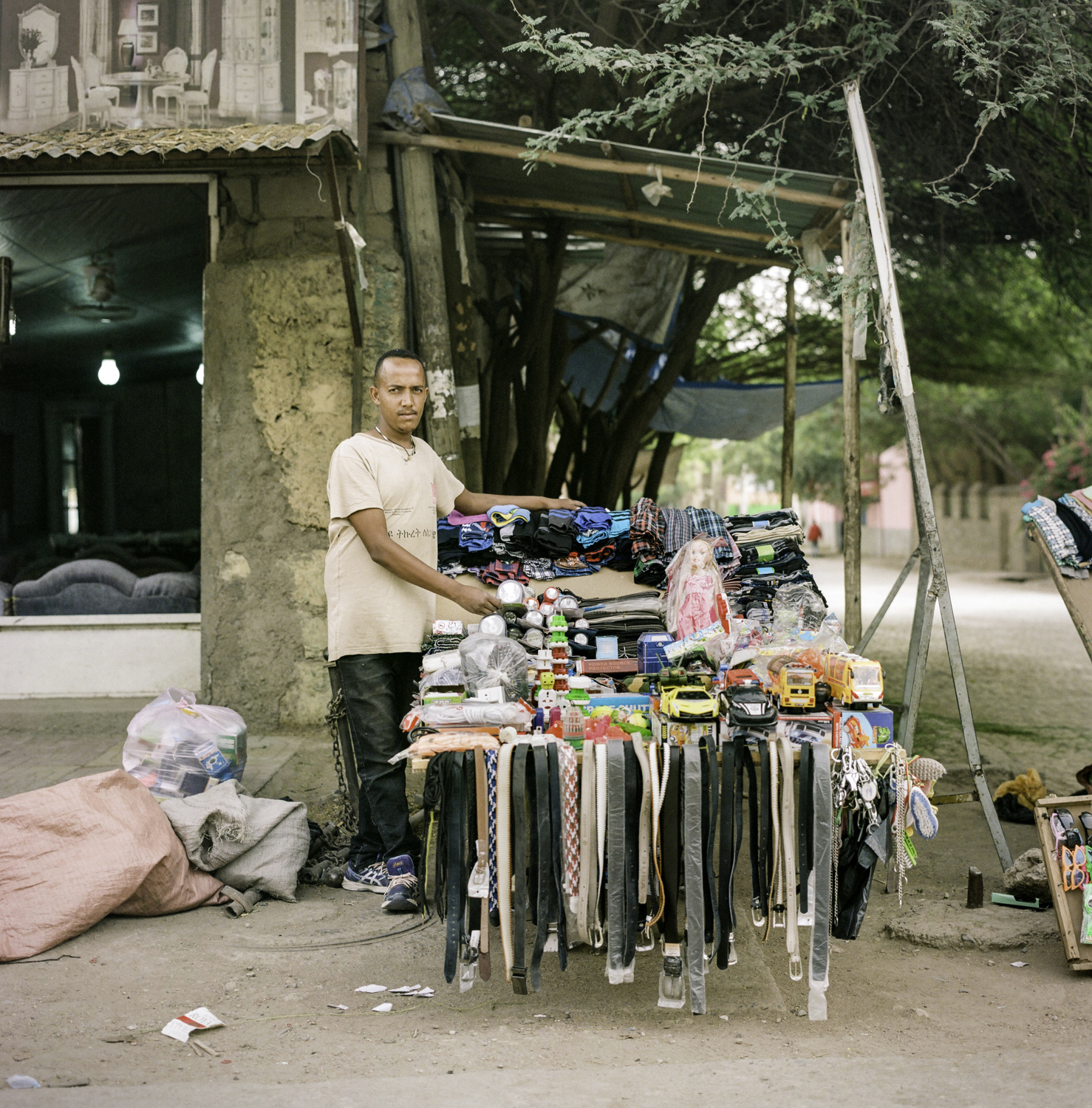 man selling toys and belts on the street in Ethiopia