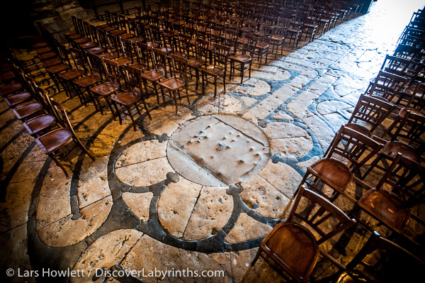 The labyrinth at Chartres Cathedral in France covered with chairs.