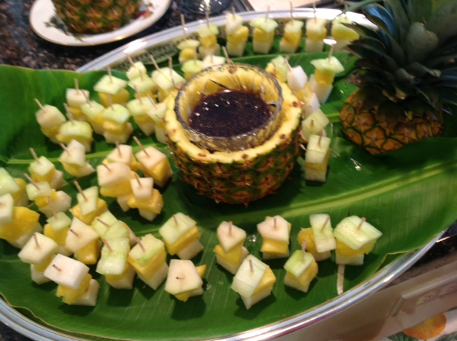 Rojak Salad becomes a cocktail snack on a toothpick with jicama, pineapple and cucumber.
