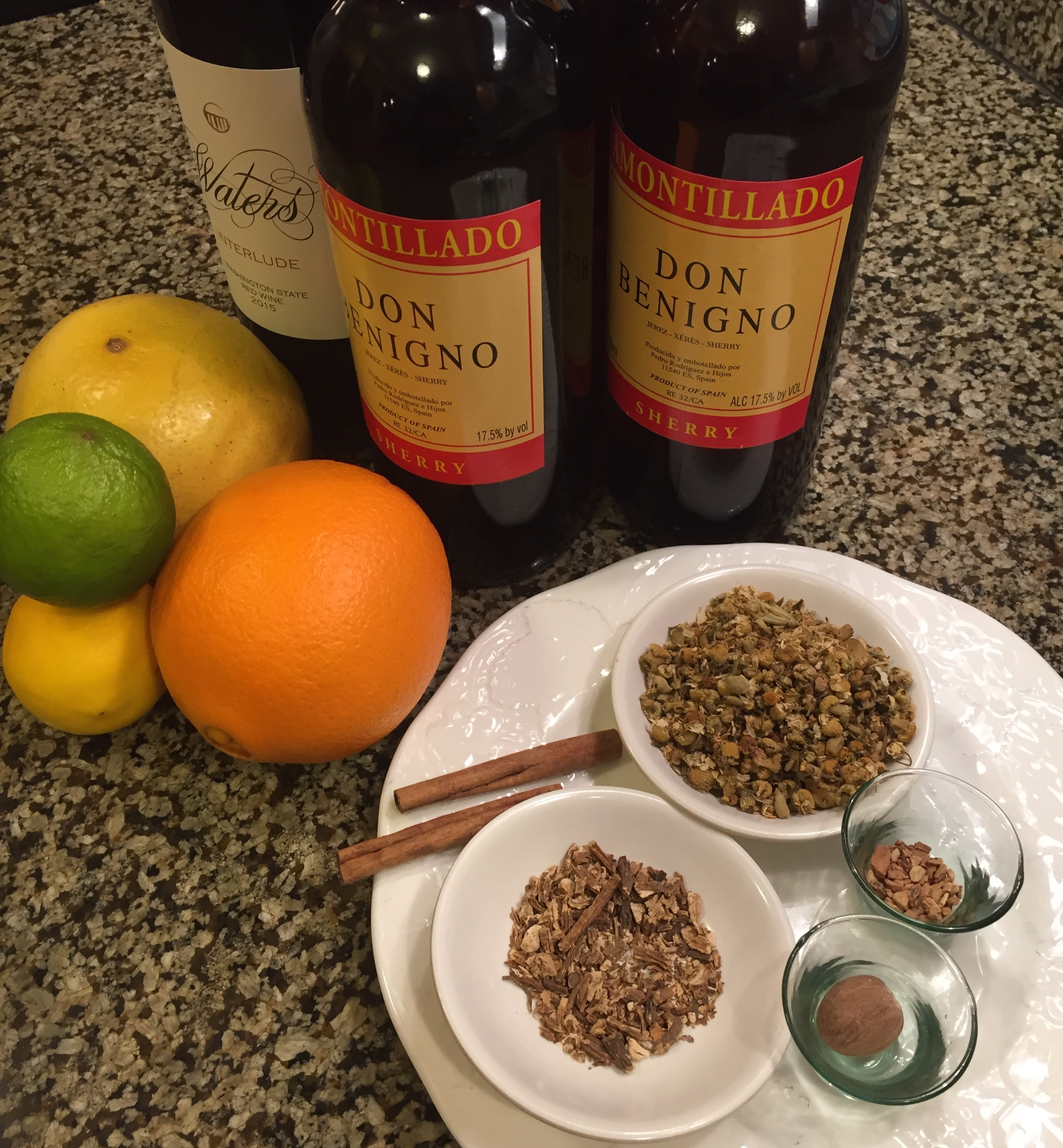 Tinto (house made red vermouth) ingredients include dried chamomile in the top bowl, angelica root in the lower bowl and gentian root and nutmeg to the right.