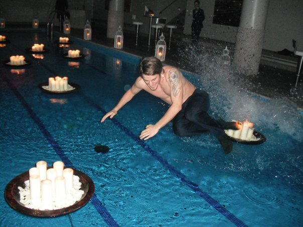 If I was a professional footballer, I'd also be setting my foot on  fire and jumping into swimming pools at least twice, possibly three  times per week. But I'd have scantily clad babes in there with me. Not  enough babes in the above photo IMO. Floating candles don't do it for me  I'm afraid. Although they seem to have got David all hot and bothered.   Good work fella xxx