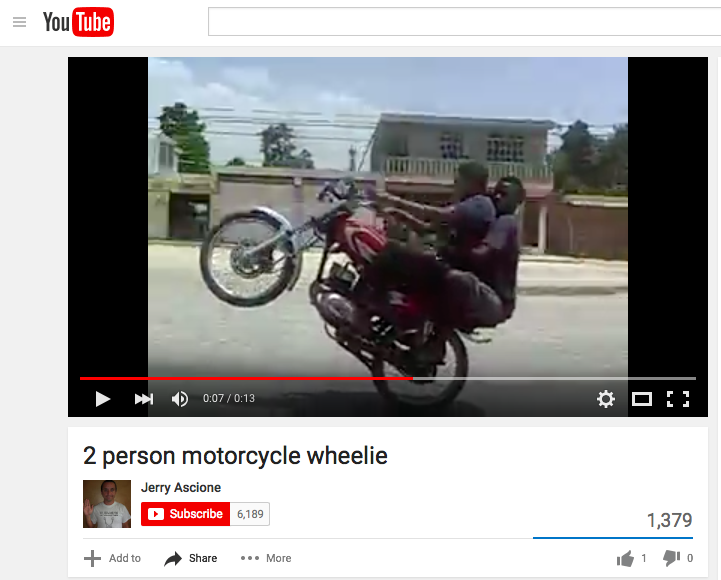A DOMINICAN TRADEMARK, THE TWO PERSON MOTORCYCLE WHEELIE.
